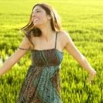 Beautiful brunette indian woman in green rice fields — Stock Photo