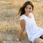Beautiful indian brunette in a golden field — Stock Photo
