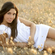 Beautiful indian brunette in a golden field — Stock Photo