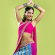 Beautiful indian young brunette woman dancing — Stock Photo