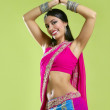 Beautiful indian young brunette woman dancing — Stock Photo #5498423