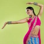 Beautiful indian young brunette woman dancing — Stock Photo