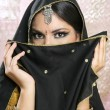 Beautiful brunette asian girl with black veil on face - Zdjęcie stockowe