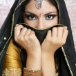 Beautiful brunette asigirl with black veil on face — Stock Photo #5498461