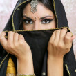 Beautiful brunette asian girl with black veil on face — Stock Photo #5498464