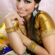 Beautiful indian brunette traditional fashion style - Stok fotoğraf