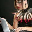 Attractive brunette fashion woman with laptop — Stock Photo