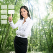 Brunette ecological businesswoman touch keypad — Stockfoto
