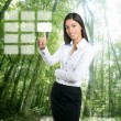 Brunette ecological businesswoman touch keypad — Stock Photo