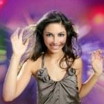 Beautiful brunette dancing night disco lights — Stock Photo