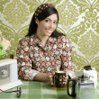 Retro woman drinking cafe on wallpaper kitchen - Stock Photo
