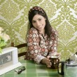 Royalty-Free Stock Photo: Retro woman drinking cafe on wallpaper kitchen