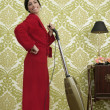 Bathrobe retro housewife woman vacuum cleaner — Stock Photo