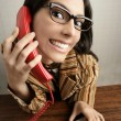 Retro secretary wide angle humor telephone woman - Stock Photo