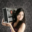 Royalty-Free Stock Photo: Retro open reel tape recorder beautiful brunette Dj