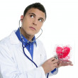 Doctor test a red heart health, young man — Stock Photo #5498978