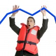 Businessman sinking in crisis, lifejacket metaphor — Stock Photo #5499141
