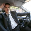 Young suit businessman inside his car — Stock Photo #5499196