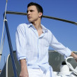 Handsome young man on boat, summer vacation — Stock Photo