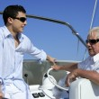 Outdoor boat vacation summer, men generation - Stock Photo