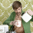Geek retro man drinking tea coffee vintage teapot — Stock Photo #5499292