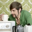 Geek retro man drinking tea coffee vintage teapot - Stock Photo