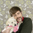 Geek retro man holding dog silly on wallpaper - Stock Photo