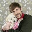 Geek retro man holding dog silly on wallpaper — Stock Photo #5499308