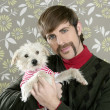 Geek retro man holding dog silly on wallpaper — Stock Photo #5499309