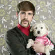 Geek retro man holding dog silly on wallpaper — Photo