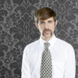 Businessman retro mustache over gray wallpaper — Photo