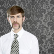 Businessman retro mustache over gray wallpaper — Stockfoto