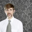 Royalty-Free Stock Photo: Businessman retro mustache over gray wallpaper