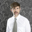 Businessman retro mustache over gray wallpaper — Stock Photo #5499320