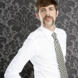 Businessman retro mustache over gray wallpaper — Stock Photo