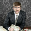 Royalty-Free Stock Photo: Businessman nerd accountant dollar notes