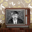 Nerd retro 60s vintage wooden tv presenter - ストック写真