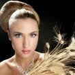Blond fashion woman holding wheat spike — Stock Photo