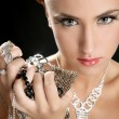 Ambition and greed in fashion woman with jewelry — Stock Photo