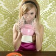 Retro woman drinking strawberry milkshake - 图库照片