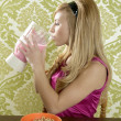 Retro woman drinking strawberry milkshake — Stock Photo #5499514