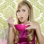 Retro woman breakfast eating corn flakes — Stock Photo
