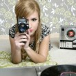 Super 8mm camera retro woman vintage room — Stock Photo