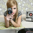 Super 8mm camera retro woman vintage room — Stock Photo #5499583