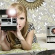 Camera retro photo woman in vintage room — Stock Photo #5499584