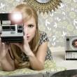 Camera retro photo woman in vintage room — Stock Photo