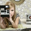 Camera retro photo woman in vintage room — Stock Photo #5499585