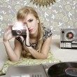 Camera retro photo woman in vintage room - Stock Photo