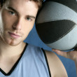Basket player young man over blue — Stock Photo