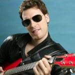 Sexy rock man sunglasses leather jacket — Stock Photo #5499757